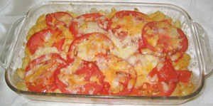 Delicious Macaroni & Cheese, just out of the oven. The cheese has melted and baked on the red tomatoes. Looks yummy